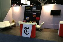The New York Times / The New York Times has a very elegant and recognizable brand culture behind its products. Our approach was to create an equally elegant booth design; branded from top to bottom that would translate that culture across all their multiple trade show appearances