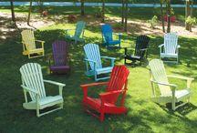 Solid Acacia Patio / Porch Furniture / Acacia Adirondack chairs, porch rocking chairs, porch swings, tables, chairs, benches, bar stools.  Available at Furniture Barn USA.
