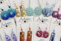 Adajio @ Regencies.com / Adajio is designed by Colorado artist Barbara MacCambridge. Inspired by a diversity of imagery -- from ancient art of the Americas to contemporary African, Asian and European motifs -- Barbara's interest in color and texture infuses each item in the collection with a unique visual appeal. Adajio items are etched, then embellished by hand with a special proprietary process that adds color and interest to each piece. Visit our website at: www.regencies.com