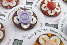 GFS button brooch