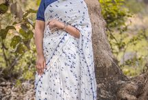 Ink Stain Muslin-Cotton Hand-painted Saree / PRICE INR 5,999/- US$ 90.00 Click here https://www.eastandgrace.com/products/ink-stain-silk-chiffon-saree Featuring the Ink Stain Muslin-Cotton hand painted saree in white with blue tassels along the border. The blue ink stain pattern is painstakingly hand-painted all over the saree. Each saree is therefore unique. The matching blue blouse has peter pan collar, puff sleeves with elastic edging and adorable white, tiny ribbon bows at the back along the closure line. Reach us:care@eastandgrace.com