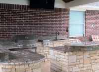 Outdoor kitchens / Our outdoor kitchens feature appliances like the Big Green Egg Grill, pizza ovens, Kegerators, sinks, smokers and more!