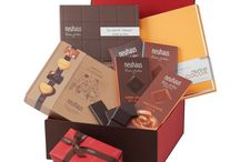 Inspiring Gifts / Belgian chocolate gifts quite simply make the perfect present. Whether ordering for a birthday, sending a Christmas present, or marking an anniversary, our fine chocolate gift boxes hit the mark. We offer a full range of chocolate gift baskets, from budget friendly samplers of our classic Belgian chocolates to sumptuously generous gift boxes loaded with our premium creations. Our European-inspired gift containers add a special touch to all our gift baskets, ensuring a lasting impression.