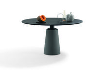 News 2015 - MESA, design Lella & Massimo Vignelli / A sculpted, almost primitive table, this icon of formal purity was first designed in 1985 by Lella and Massimo Vignelli and has now been revisited by Poltrona Frau.