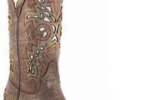 cowboy boots / by Sara Mirkalai
