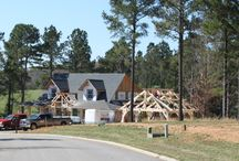 Bald Cypress Timber Frame Porte-Cochere / Bald cypress Porte-Cochere for parking beside White oak Timber Frame home still under construction near Athens, TN.