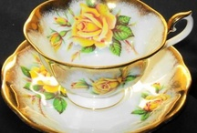 Yellow roses in cups