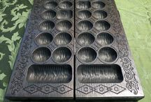 """Bao (mancala board game) / This custom Bao board is made of solid Walnut and finished with an Ebony stain and satin clear coat. It measures 25-1/2"""" L x 14"""" W x 1-1/2"""" H. Bao is a traditional mancala board game played in most of East Africa."""