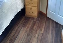 Merges Home / Flooring designed by Caty Greseth.  It looks like hardwood but is actually a luxury vinyl plank.  Invincible brand in color McIntosh.