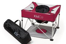 Go Pod Plus / KidCo Go Pod Plus is a lightweight, portable activity seat with padded cushion.  The removable padded cushion provides comfort and support.  Lightweight aluminum frame makes travel a breeze.  Five loops to attach baby's favorite toys.  Floor pad keeps baby's feet from touching undesirable surfaces.  Drink and snack holders.  Includes storage/carry bag.  Lightweight, only 4.5 lbs.