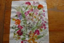 Flower Pounding Prettiness  / This is an old and fun way to transfer the colors of flowers and leaves by pounding them to paper or fabric.  You and your little ones will love it!  Give it a try!