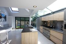 Project: Onslow Avenue / A bright and modern rear and side extension using aluminium bi fold doors as the rear patio doors and a structural glass side infill extension using glass beams.