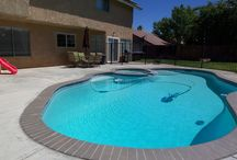 1402 Windsor, Palmdale California Home for Sale / Great Location in West Palmdale! Charming two story turn key home features three bedrooms and two and a half bathrooms, living room with a fireplace, family room that leads to a backyard with a beautiful pool and jacuzzi. Newly remodeled kitchen with tile flooring light and bright. Close to shopping, schools, and the park.
