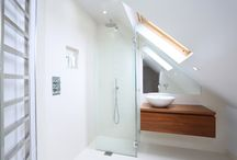 Loft Shower Rooms / Typically loft bathrooms are incorporated into the pitch of the roof and in line with the staircase.   Ultimately we try to place priority on the bedroom and therefore this limits the size of the shower room/ bathroom. It is important to consider certain aspects when designing a loft shower room in order to make the space feel as large as it possibly can.