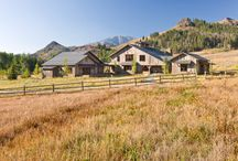 Sun Valley Family Lodge / Like many things in the American West, this lodge has its roots in the East. Beginning life as a post and beam barn in Vermont, this reclaimed structure served as the primary focus with extensions leading to the master suite, garage and artist's studio all surrounding an outdoor patio replete with fireplace.  The perfect place for this expanding Chicago family to gather and reconnect for skiing and fishing.