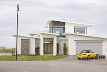 "Customer Home by the Water / John and Joanne had seen a G.J. house they really liked in Australia. The team at G.J. Gardner Homes flew back to Australia with them to look at the house and modify it to meet New Zealand conditions. ""We had a lot of fun. We have a house we just don't want to leave, it has the feeling you are on a cruise ship. G.J.'s literally went the extra mile and built a truly magnificent home."""