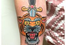 Tiger Tattoos / Tiger Tattoos are undeniably inspiring a lot of professional tattoo artists these days.... http://fabulousdesign.net/tiger-tattoos-meanings/