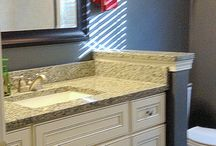 Colin's Two Bathrooms / Here are two bathroom remodels that were completed in February of 2014 for Colin - one has a contemporary feel, while the other is more transitional. Both are equally beautiful designs by one of our designers here at Johnny Rhino.