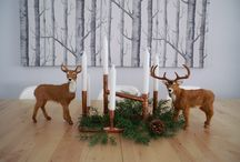 Dining table christmas centre piece / A combination of a copper pipe candelabra, faux deers and pine tree sprigs from our garden
