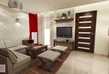 PROJEKT WNĘTRZA DOMU SIEPRAW / Delikatne kremy, ciepłe brązy i zmysłowa czerwień uzupełnione dodatkami dekoracyjnymi i materiałowymi jak kryształowe lampy i kinkiety, łupek gipsowy, ciemne drewno, tapeta ze wzorem stały się elementami tworzącymi wspólną kompozycyjną całość. W jednorodzinnym domu poddanym procesowi rozbudowy, powstało nad wyraz piękne i wyrafinowane wnętrze.