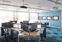 """Anglian Ruskin Universty / Converting an existing classroom into the """"Bloomberg Financial Market Laboratory"""" for training in financial markets. Including designer flooring, decoration, electrics, wall cladding with inset to monitors, bespoke entrance canopy with LED lighting and live feed ticker-tape display and automatically operated, fire rated entrance doors"""