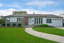 SOLD - 7047 Emerson St - Morton Grove, IL. 60053 / $242,900 - Come home to this 2 bedroom, 1 bathroom ranch home with attached 1 car garage. Interior features a roomy combined living and dining room with floor-to-ceiling window, carpeted floors and laundry room with overhead cabinets. Spacious kitchen has custom cabinets, pantry-closet, hardwood flooring and an eating area leading to sun room.  Both bedrooms have ample closet spaces and dazzling natural light. Full bathroom has jetted tub and natural light from glass blocks.