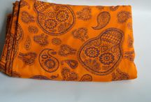 New 'SMP Aurantiaco / A strikingly beautiful cornucopia of paisleys and sugar skulls ornamented with lacy trimmings and fine details all intricately woven together in a pumpkin orange and midnight blue colour way.