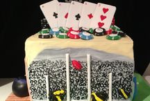 5 sided sport cake.  / Cricket, Australian Rules Football, golf, ten pin bowling, poker.  Layered mud cakes- dark chocolate, milk chocolate & white chocolate. Filled and covered with white choc ganache. Finished with fondant details. Isomalt 50 topper.