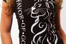 LION Christian T-Shirt - Black & White  / Women, look bold with a stylish swagg in this Royal Lion F.O.G. FAVOR OF GOD Christian T-Shirt! This ribbed crew-neck t-shirt, features the bold Lion design in a white color on the front of the T-shirt. It also has a wreath design at the right sleeve of the T-shirt in a white color print. In addition, this exclusive T-shirt features hidden letters in design of the Lion which makes it really unique and a true must have !!!  / by F.O.G. FAVOR OF GOD