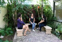 The Courtyard / Planning a birthday party, dinner, corporate or other special event? The Hub on Canal provides a creative setting to host your gathering. Located in the heart of New Smyrna Beach, The Hub on Canal offers a unique art-filled interior with one-of-a kind artwork, small studio spaces, a central gathering space, and a beautiful courtyard.