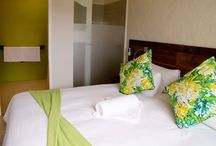 Room 1 - Wagtail / This beautiful downstairs room is decorated with highlights of lime green. The en-suite bathroom has a double basin and spacious shower. The unit opens out onto the patio.