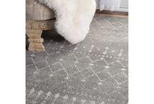 Hard wood apt = rugs