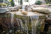 Water Features - Ponds, Waterfalls, Pondless Waterfalls / Welcome to the world of water gardening! Yes, even in Pittsburgh!  The calming sound of flowing water is therapeutic to the mind and soul. It relaxes and soothes while adding great beauty to your yard! Pittsburgh Stone and Waterscapes will help you create a water feature that best suits your wishes and budget.   We can do ponds with fish or without and also pondless waterfalls. Our systems are low maintenance and we also provide spring opening and winter closing services.