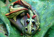 драконы