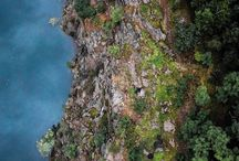 What height of the cliffs would you estimate if you see this drone shot? And can you spot the yellow jacket?