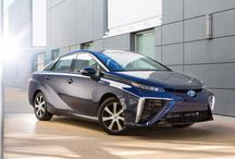 "Toyota Mirai / In Japanese, ""mirai"" means ""future"", and the Toyota Mirai is the future of motoring! Running solely on a hydrogen fuel cell, the Mirai is redefining the idea of an environmental friendly vehicle as the Mirai's only emissions are water. It's range is about 300 miles and fuel is included for the first three years of ownership."