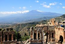 Taormina, Sicily Tour & Design Ideas / The city, precariously set on Monte Tauro, rises 650 feet above the sea, dominating grand, sweeping bays along the eastern coast of Sicily. It offers visitors a dramatically memorable view of Mount Etna and over one hundred miles of Mediterranean Sea.