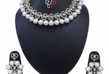 Pearl Necklace Set in Hearts studded with zircons at Rs5,500.