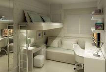 Dormitório com cama alta