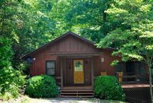 Bear Bottom Creek / This cozy secluded cabin is perfect for honeymoons, anniversary getaways, and other special occasions. Listen to the sounds of the nearby creek as you enjoy the outdoor hot tub on the screened porch. Mountain laurel surrounds the creek and the cabin.