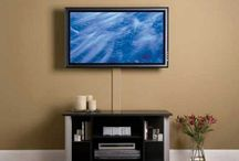TV Mounts/ Displays Of Flat Screens / Besides learning how to hang up a flat screen tv, you can also learn how to hide the wiring or install the wiring behind the wall.. great ideas / by Maria Freeman