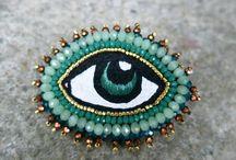 Broches ojo