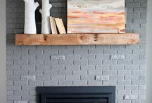 a frame living room / White walls, paint the fireplace brick grey, add wood mantle + new light fixture/fan