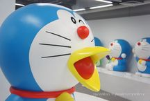 Doraemon / A future robotic cat with a pocket filled with gadgets.