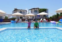Crete - holiday rental  friendly for families with children / Place : Chania   individual apartments self catering Wi-Fi internet, Air conditioned, large swimming pool to share , TV, Video.          Capacity: up to 4 persons. In the property are many playgrounds  with  pedalo-crts, bouncer, sliders  and games free to use any time . Pool: Large outdoor pool and pool for children (0.5 m) freshwater.