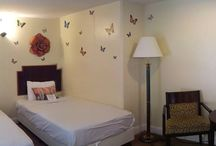 Family Suite- Butterfly themed sleeping area / 4 adults, 2 children maximum - 2 double, 2 single beds. Partial oceanview guestroom.