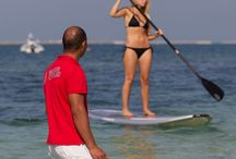 Stand up Paddleboard / Yoga on a stand up paddleboard and kayking. Come to our centres at Watercooled Jumeirah Beach, Dubai and Hiltonia, Corniche Abu Dhabi
