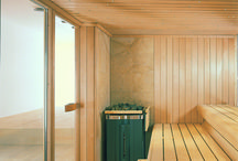 Proteo Sauna / Klafs Sauna Proteo. The open design of the Proteo makes a whole range of delightful interior details visible from the outside. The heater corner in natural stone features the large MAJUS. The extra wide benches extending as far as the back rests. The OLYMP lamp, and, as if all this were not enough, the model can be upgraded with further extras and design elements. #klafs #sauna #proteo #design #interiordesign