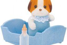 Sylvanian Families zabawka Dziecko Łaciatych Piesków / Wyjątkowe zabawki dla dzieci marki Sylvanian Families