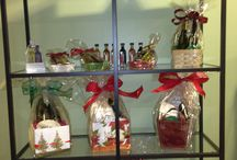 """Gift Ideas / We have gift baskets to make all your #GiftGiving even easier. Custom create your gift with the #OliveOil and #Balsamic of your choosing. We're happy to help you find just the right pairing for """"olive"""" the special people on your #GiftList. And don't forget to gift yourself the #HealthBenefits and #Recipe Enhancing qualities of our products."""